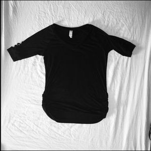 Black fitted top with crisscross neck and sleeves